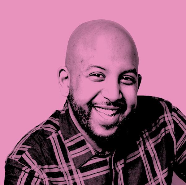 Image Description: A Pink filtered photograph of Hisham Kelati