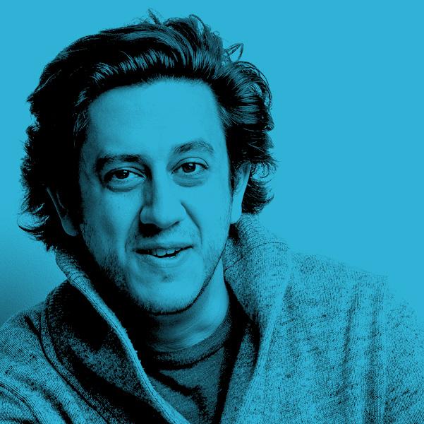 Image Description: A Blue filtered photograph of Kris Siddiqi