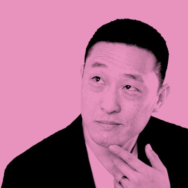 Image Description: A Pink filtered photograph of Leonard Chan