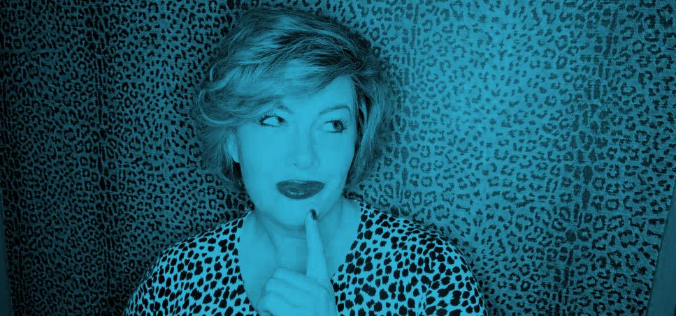 Image Description: A blue filtered photograph of Shannon Laverty.